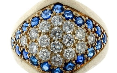 Gold ring set with a pavé of brilliants in a...