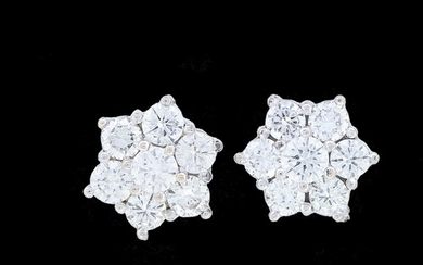 PAIR OF DIAMOND CLUSTER EARRINGS, set with diamonds totallin...