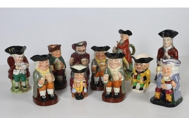 A COLLECTION OF ELEVEN TOBY JUGS to include six Royal Doulto...