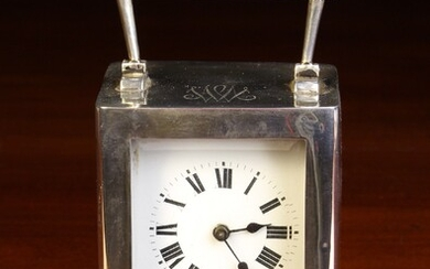A Cased Silver Carriage Clock by William Aitken hallmarked Birmingham 1913 with a French movement....