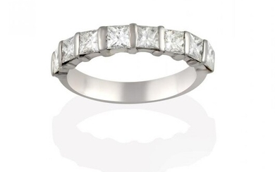 A Diamond Half Hoop Eternity Ring, the princess cut diamonds...