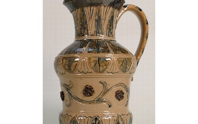 A Doulton Lambeth ewer with silver lid: Decorated by Arthur ...