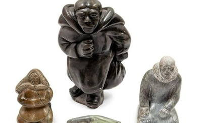 A Group of Inuit Soapstone Carvings largest figure