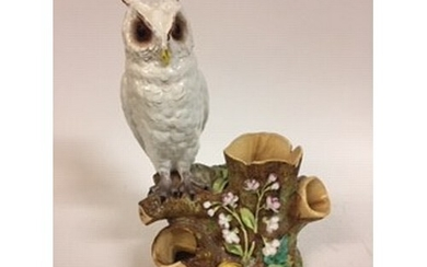 A Moore Brothers figure of a long eared owl, perched on a br...