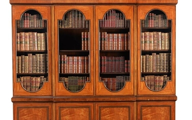 A SATINWOOD AND MAHOGANY CROSSBANDED BREAKFRONT LIBRARY BOOKCASE, IN GEORGE III STYLE