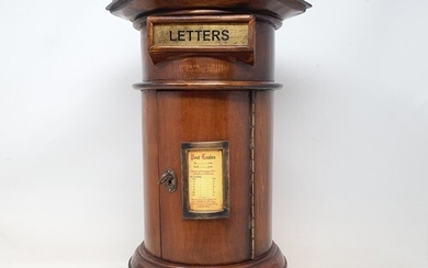A Victorian style country house letter box, with an hexagona...