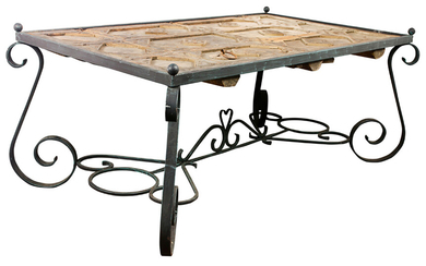 A Wrought iron and distressed wood dining table