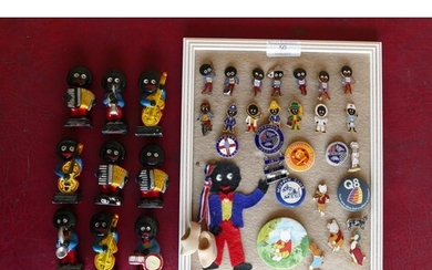 A collection of Golly pin badges and nine Golly band painted...