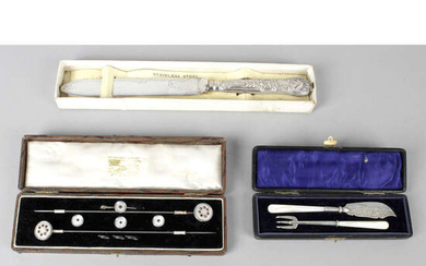 A collection of assorted items to include a silver-handled cake knife, etc.