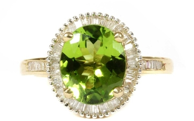 A gold peridot and diamond cluster ring