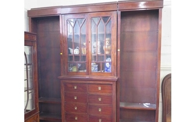 A mahogany breakfront bookcase cabinet, the moulded cornice ...