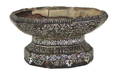 A mother-of-pearl inlaid lacquer talum (pedestal tray), Thailand, late 18th century, the foot and tray each with ten sides inlaid with various typically Thai designs and motifs against a black lacquer ground, the shoulder of the foot and shoulder...