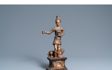 A polychromed wooden figure of Saint Adrian on a reliquary b...