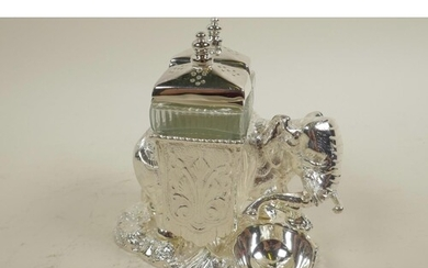 A silver plated 'Elephant' cruet with glass salt and pepper ...
