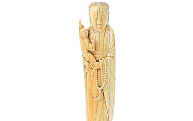 AN IVORY FIGURE OF A LADY AND CHILD