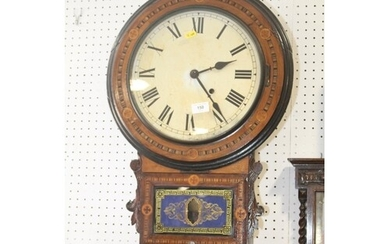 An American walnut and marquetry banded wall clock with whit...