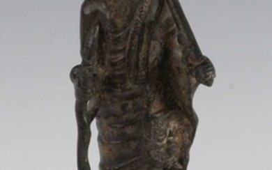 Lot details * A Chinese cast bronze figure of...