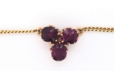 Three stone ruby pendant on 18k yellow gold chain, approxima...