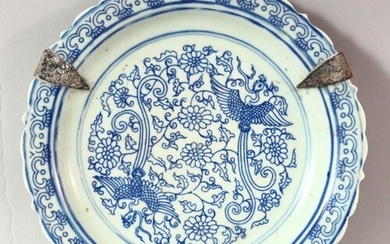 A CHINESE BLUE AND WHITE PORCELAIN DISH, the centre decorate...