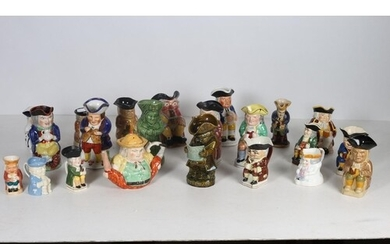 A COLLECTION OF TWENTY TWO TOBY JUGS to include a Clarice Cl...