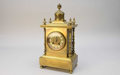 A French brass mantel clock, late 19th century