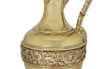 A gilded Victorian silver claret jug by Stephen Smith, London, c.1881, the bulbous body with a band of chased lions, vines and putti raised on a circular stepped foot, the high handle decorated with leaves and beads curving to a hinged lid with...