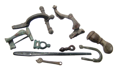 A group of Roman bronze fibulae and artifacts