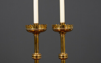 A pair of Victorian turned brass candlesticks