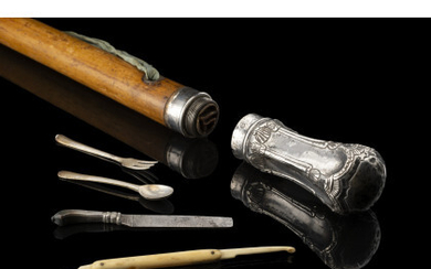 A pic-nic malacca walking stick with a detachable knob hiding a silver and bone cutlery set. Metal toe cap. Naples,…Read more