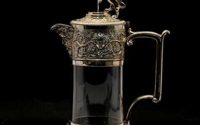 A silver-plated claret jug
