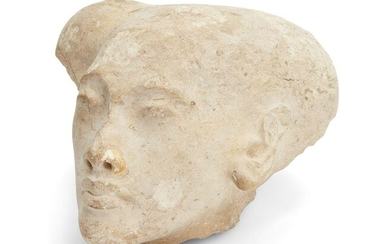 A sizeable Egyptian style limestone head of an Amarna style princess, with elongated skull with the top of the sidelock remaining and defined features, Not Ancient, 28.2cm long, 23cm wide, 17cm high Provenance: Formerly in the private collection of...