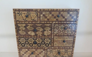 An Oriental parquetry inlaid eight drawer jewellery / collec...