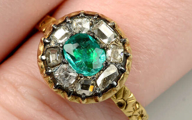 An emerald and vari-cut diamond cluster ring, with floral band.