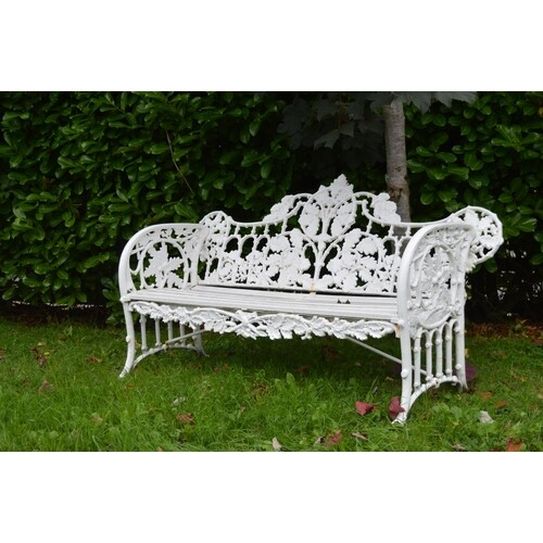 Cast iron garden bench in the Coalbrookdale style with oak l...