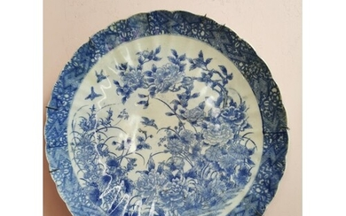 Chinese 19th C. blue and white ceramic charger decorated wit...