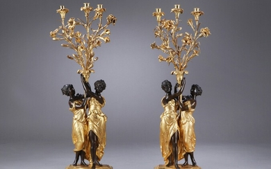 A pair of Louis XVI candelabra in ormolu-gilt and patinated bronze, second half of the 18th century (2)