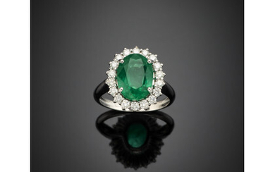 *Oval ct. 3.80 circa emerald and diamond white gold cluster ring, diamonds in all ct. 0.35 circa, g 5.49 circa size 14/54. Appended gemmological report CISGEM n. 18848 11/05/2021, Milano