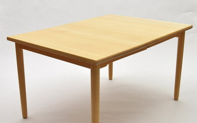 Rectangular extendable wooden dining table, executed by Rubby / Denmark...