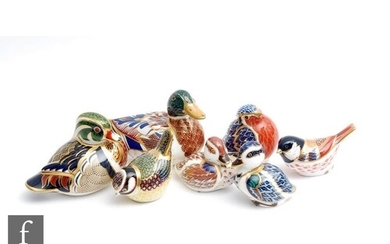Seven assorted Royal Crown Derby paperweights comprising a C...
