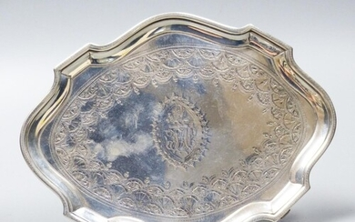 A George III silver shaped oval teapot stand, Charles Hough...