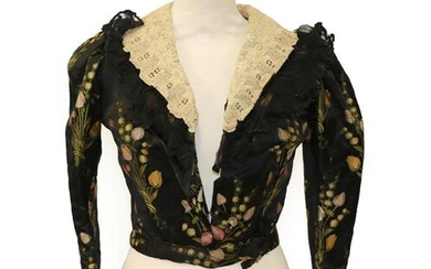 A Late 19th Century Black Silk Brocade Jacket, woven with...