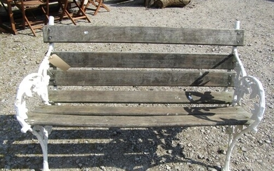 A Victorian style cast iron and teak garden bench with black...