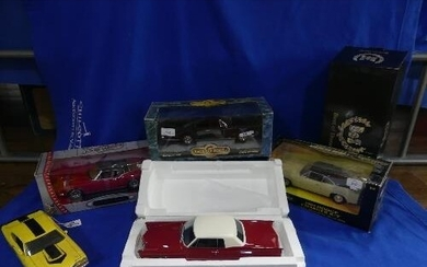 A collection of five 1:18 scale die-cast models, including R...
