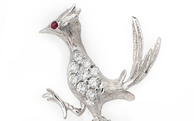 NOT SOLD. A diamond and ruby brooch set with numerous diamonds and a ruby, mounted...