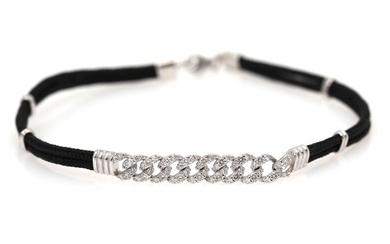 A diamond bracelet set with numerous diamonds weighing a total of app. 0.68 ct., mounted in 18k white gold and black string. L. app. 18 cm. – Bruun Rasmussen Auctioneers of Fine Art