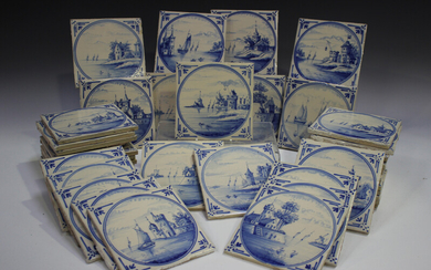 A group of approximately sixty Dutch Delft blue and white tiles, late 19th/early 20th century, each