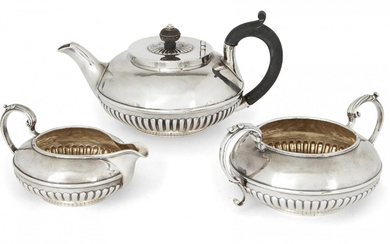A matched George IV three-piece silver tea set, London, c.1826, (teapot) and London, c. 1839, Richard Sibley II, the set comprising a teapot, sugar and milk jug, each of squat, circular form with half-lobed bodies engraved with lion armorial to one...