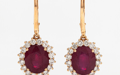 A pair of 18K gold earrings with ca. 11.32 ct of rubies and 1.39 ct of diamonds according to certificate.