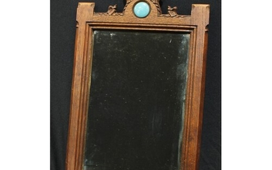 An Arts and Crafts Gothic style mirror, inset with Ruskin pl...
