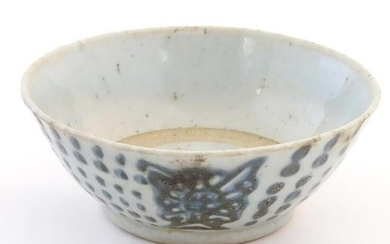 An Oriental earthenware bowl with brushwork detail.